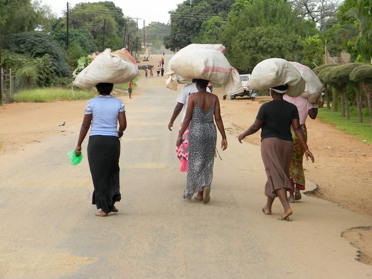 A group of woman walking in a street in Zimbabwe